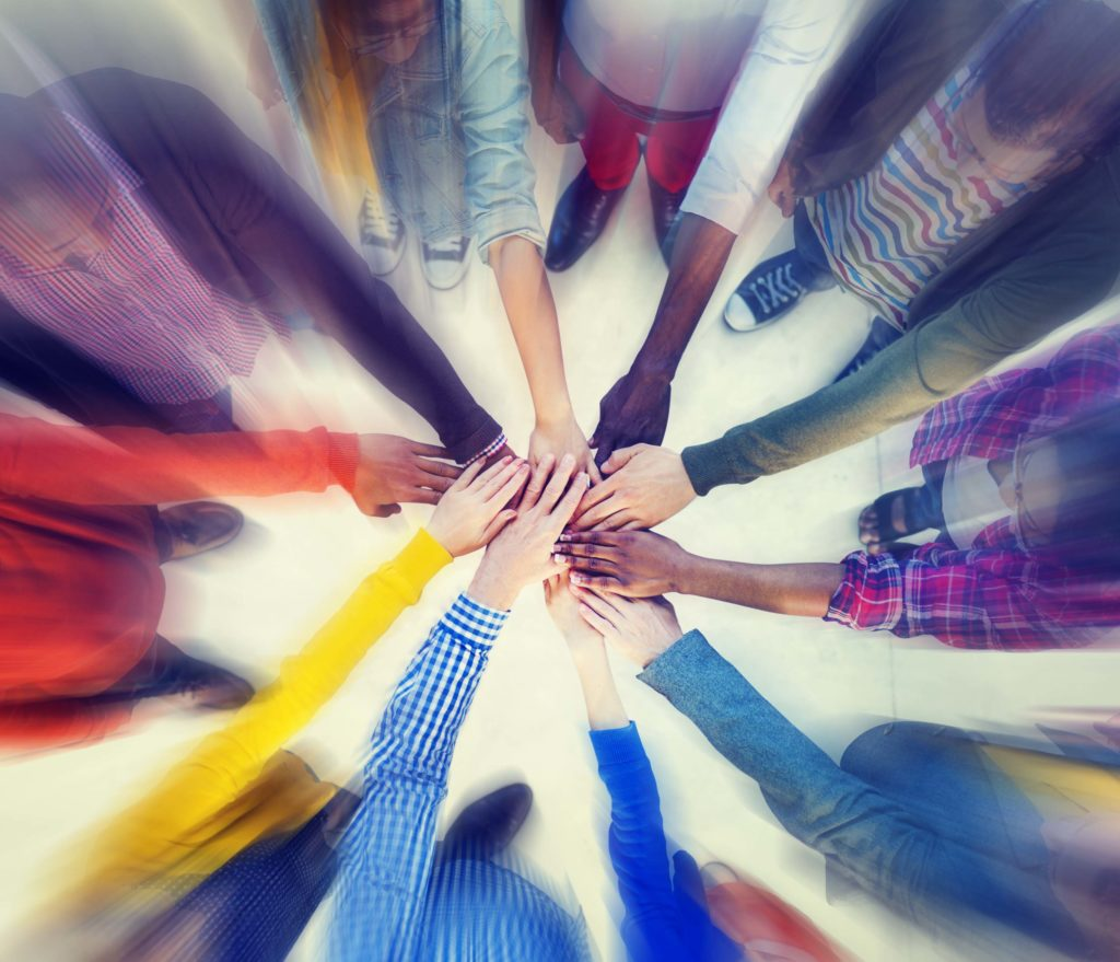 Group Of People Hands Clasped Concept Autism Hope Alliance