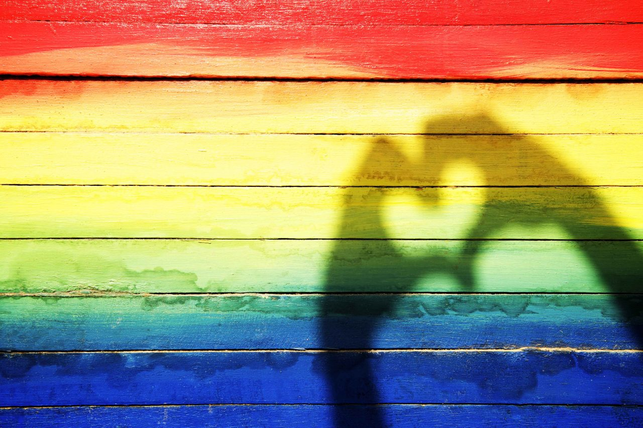 Hands Making Love Heart Shadow On Rainbow Background